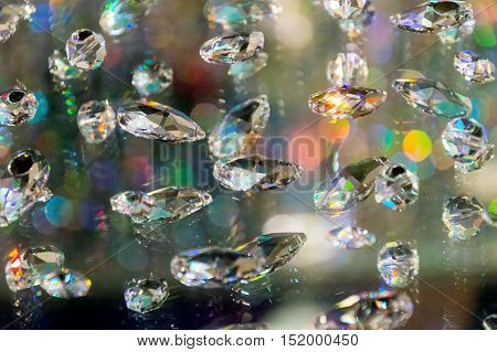 Large crystal strasses on a blur colored background. low depth of field.