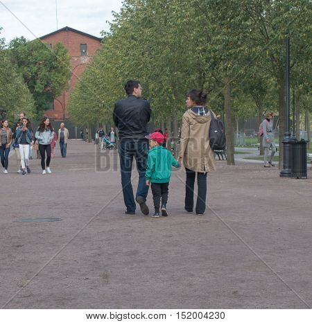 Saint Petersburg Russia September 04 2016: A couple with a child walking along the Avenue in the Park in St. Petersburg Russia.