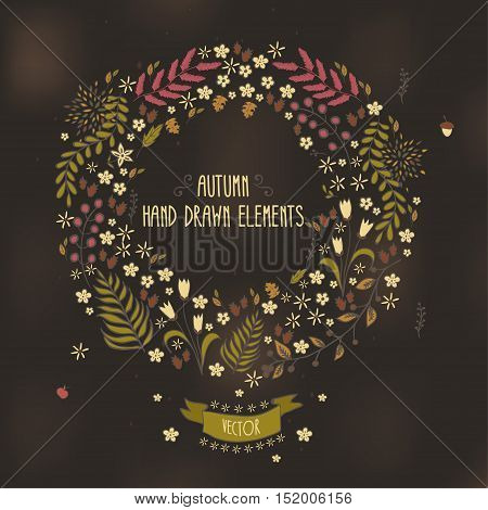 Autumn hand drawn wreath. Autumn leaves, twigs, berries, flowers. Vector