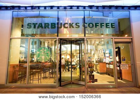 CHICAGO, IL - 01 APRIL, 2016: Starbucks cafe at night. Starbucks Corporation is an American coffee company and coffeehouse chain.