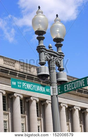 Pennsylvania Ave street sign on lamp against old building