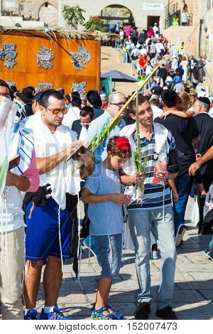 JERUSALEM, ISRAEL - OCTOBER 12, 2014: Blessing Cohen in Sukkot. Religious Jews have come to the Western wall of the Temple. Morning autumn Sukkot