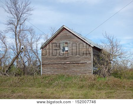 An old abandoned granary that was probability used to store different grains wheat, oats, barely and etc.