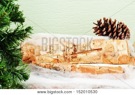Abstract Cristmas composition from fir branches and birch logs.