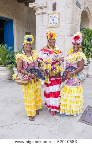 HAVANA CUBA - JULY 18 : Cuban women with traditional clothing in old Havana street on July 18 2016. The historic center of Havana is UNESCO World Heritage Site since 1982.