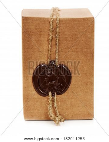 Cardboard box with wax stamp isolated on white background.