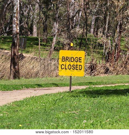 Yellow bridge closed sign in an Australian park
