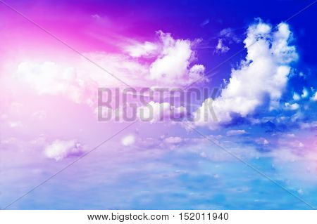 Land, blue sky and beautiful clouds with sun.