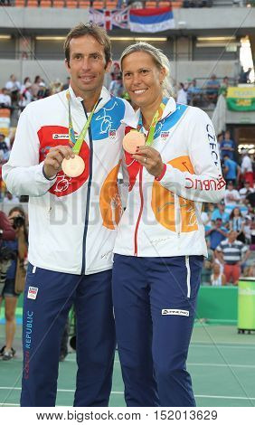 RIO DE JANEIRO, BRAZIL - AUGUST 14, 2016: Bronze medalists Radek Stepanek (L) and Lucie Hradecka of Czech Republic during medal ceremony after tennis mixed doubles final of the Rio 2016 Olympic Games