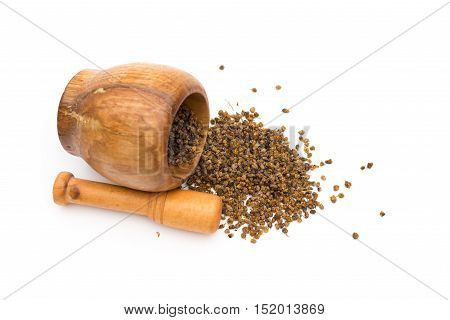 top view wooden mortar and pestle with flos chrysanthemi indic on white background