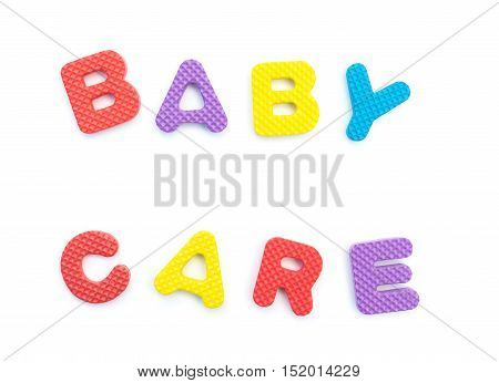 letters of baby care made by alphabet jigsaw puzzle on white
