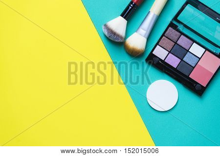 Set of cosmetics on colorful background, top view