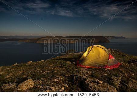 Illuminated Camping Yellow Tent Night High Altitude Alpine Landscape Shining Moon in Dark Blue Sky