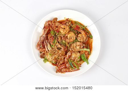 Stir-fried crab and shrimp in curry power is top-ten of popular Thai food as seafood to fried with  fresh milk ,grill curry ,egg ,oyster oil and yellow curry power.