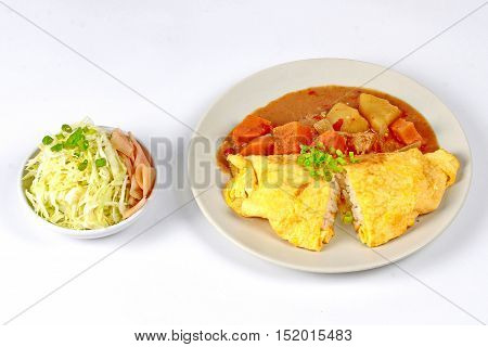 Omelet jasmine rice topped Japanese yellow curry  with sliced cabbage and pickled ginger isolated on white background.