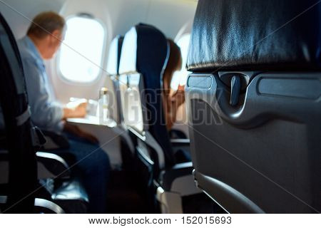 passanger in aircraft cabin. Interior passenger airliner cabin.