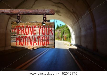 Improve your motivation motivational phrase sign on old wood with blurred background