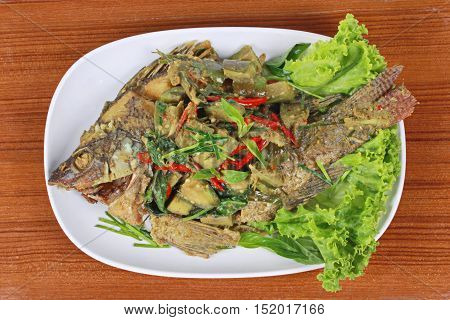 Green curry with  deep fried tilapia fish in coconut milk is popular Thai cuisine .