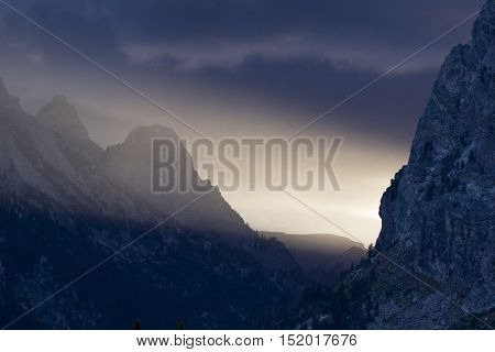 Strong directional beam of light beam in cascade canyon of the Tetons