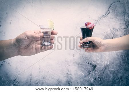 Drink Responsibly!  Adult Hand With Shot Of Tequila And Kid Hand With Cola And Jelly Bears
