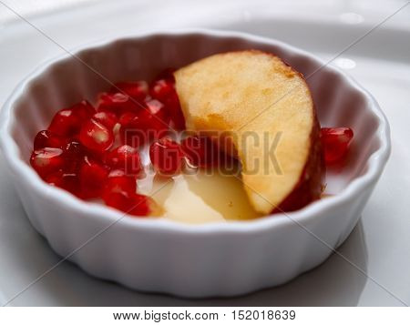 Rosh hashanah Jewish New Year holiday tradition of dipping apple in honey