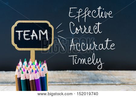 Business Acronym Team Effective Correct Accurate Timely Written With Chalk On Wooden Mini Blackboard