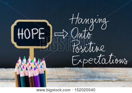 Business Acronym Hope Hanging Onto Positive Expectations Written With Chalk On Wooden Mini Blackboar