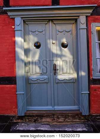 Traditional colorful craft vintage wooden light blue front door Denmark