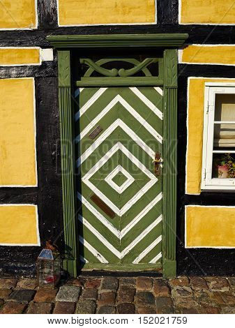 Traditional colorful craft vintage wooden green white front door Denmark