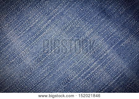 Denim jeans texture or denim jeans background. Old grunge vintage denim jeans. Stitched texture denim jeans background of jeans fashion design. Dark edged.