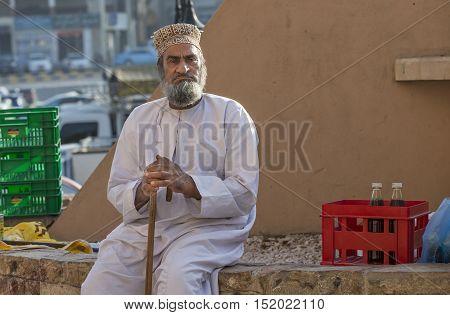 Nizwa Oman October 13th 2016: old mad resting on Nizwa market