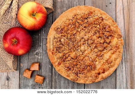Apple, Caramel Crumb Pie, Overhead Scene Against A Rustic Wood Background