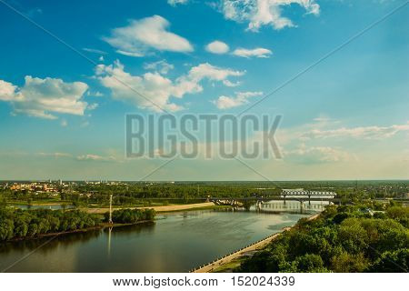 Landscape of the city with the river and the bridge. Blue sky. Nobody