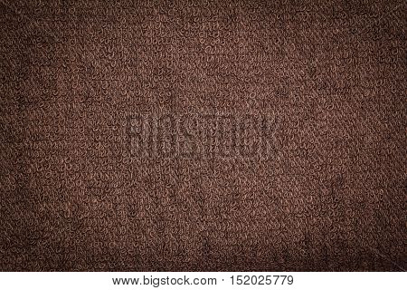 Closeup brown towel cloth and brown towel texture from towel beach for background and design with copy space for text or image. Dark edged.