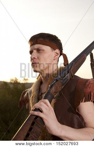 Hunter in vintage clothes ready to hunt with hunting rifle