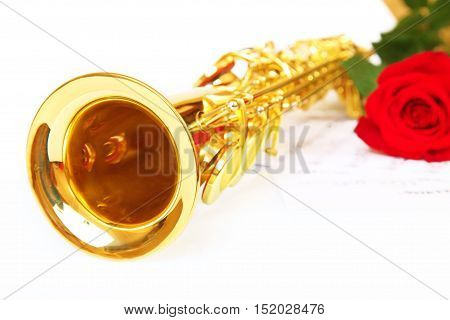 Musical notes and saxophone with red flower