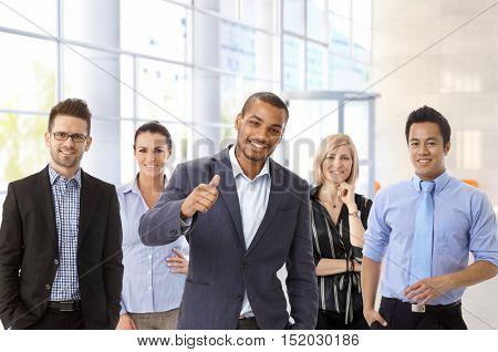 Team portrait of diverse interracial business group.