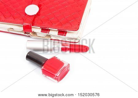 Red nail polish and brush dripping. Isolated on white