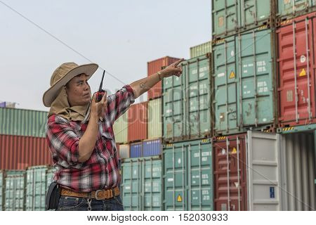 Supervisors discussed in the harbor ,checking container.