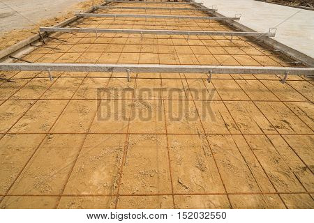 Prepare for structure of the road before pouring concrete.