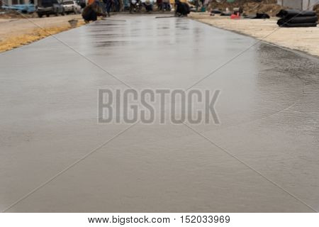 The concrete pouring is completed.But cement is not dry and are not ready to use.