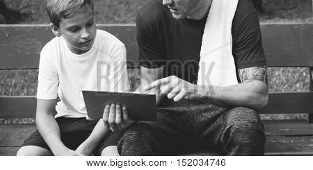 Boy Training Outdoors Exercise Tablet Concept
