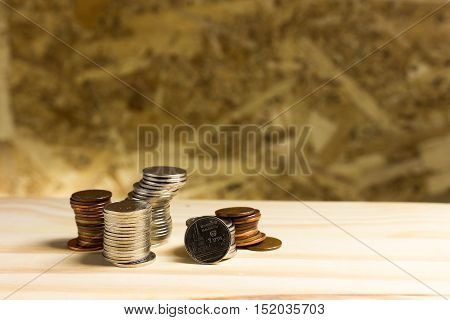Still Life.pile Of Money, Thai Coins Of One Bath On Wood Background.concept Of Financial Planning An