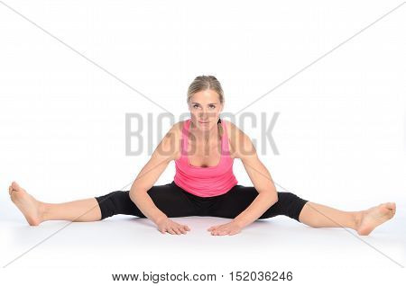 Young Woman Performing A Straddle Split Stretch