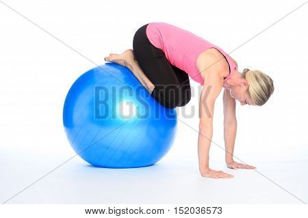 Sporty Woman Working Out With A Pilates Ball