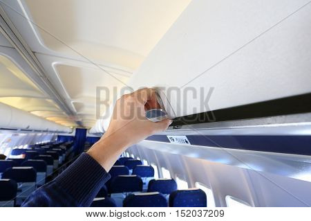 Hand Opening White  Luggage Panel .in Airplane
