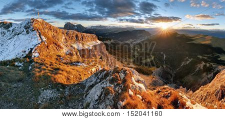 Witner autumn mountain at sunset Val Gardena from peak Seceda Dolomites.