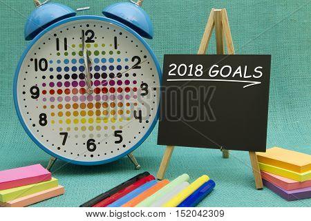 2018 New Year goals written on a small blackboard.