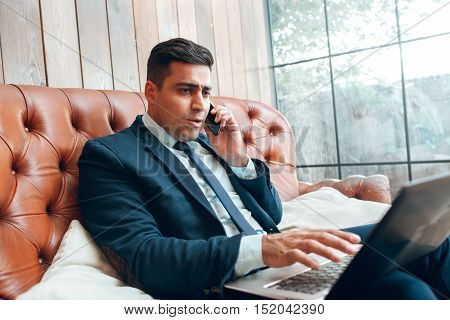 Man conducting negotiations on the web. Telecommunications concept. Means of communication and business.