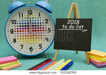 2018 New Year to do list written on a small blackboard.